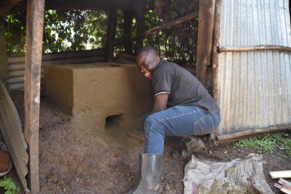 Sam building a rocket stove